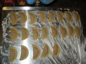 Ravioli on baking sheet with cornstarch