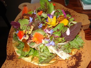 Flatbread with fresh greens, vegetables, flowers from the garden with pecorino cheese